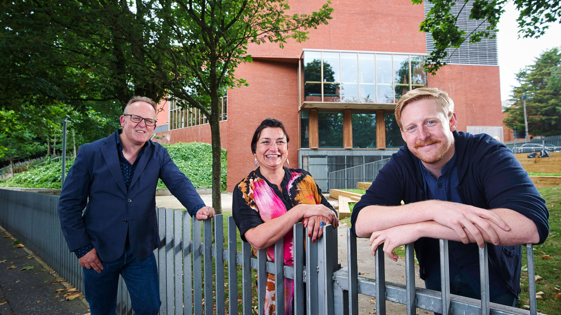 Jimmy Fay, Emma Jordan and Michael Patrick standing around the fence outside the Lyric Theatre