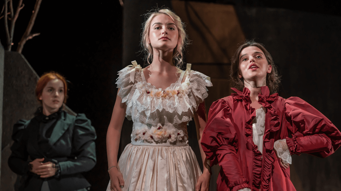 A still from the Lyric Drama Studio's production of Dracula, featuring three female actors on stage.