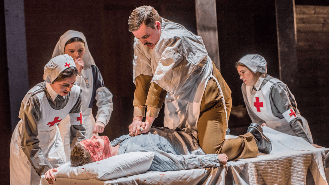 A still from the Lyric Drama Studio's production of Dracula, featuring five actors on stage.