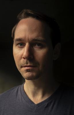 A close up headshot of Paul Mallon.