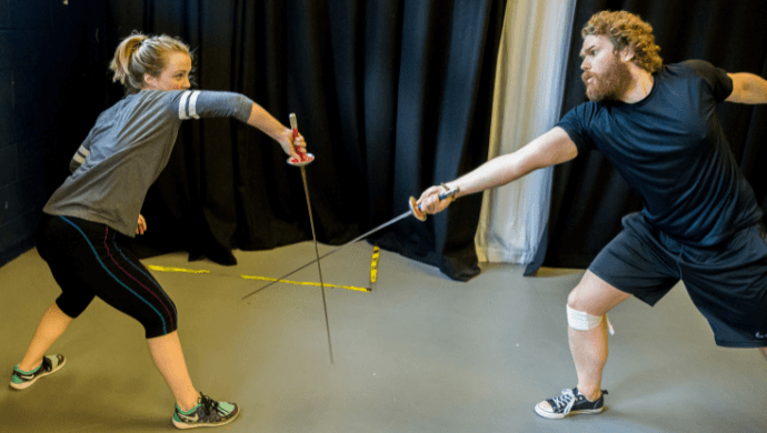 Two people fencing.