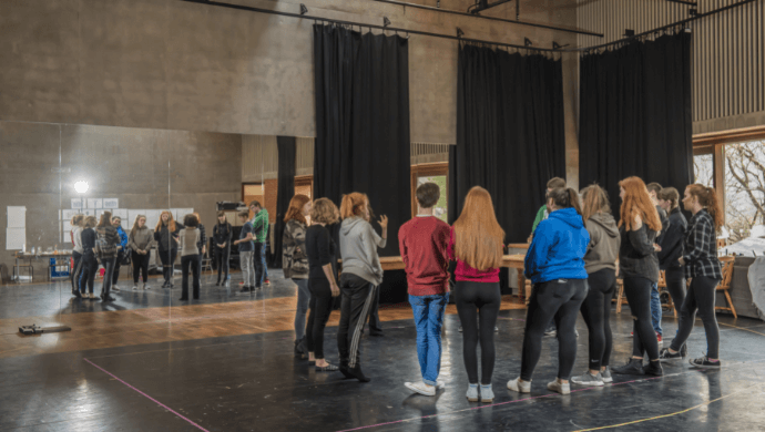 A group of young people attend the Lyric's Theatre School in the Rehearsal Room.